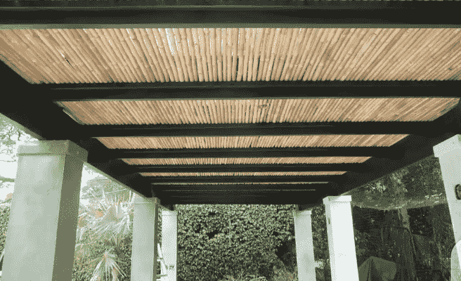a pergola with a roof